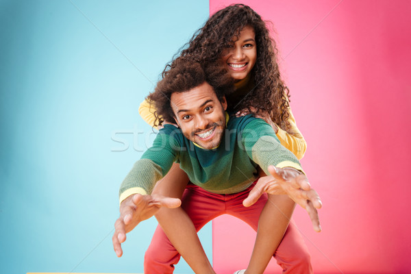 Happy playful african american young couple having fun Stock photo © deandrobot