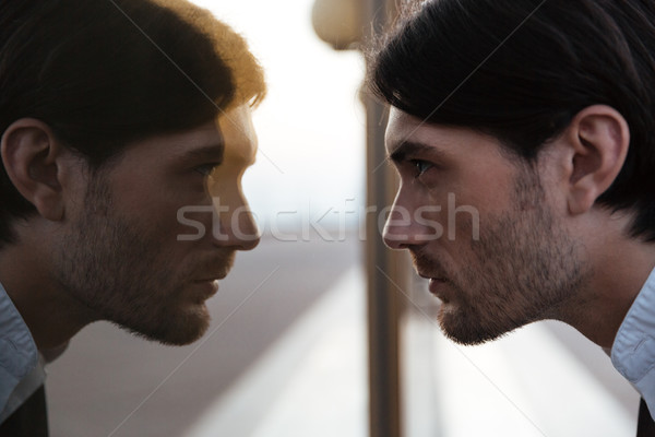 Man in suit looking at mirror Stock photo © deandrobot