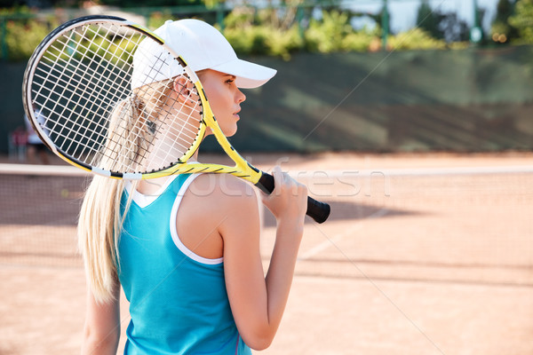 Back view of tennis woman Stock photo © deandrobot