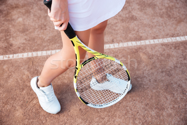 From above legs of tennis woman Stock photo © deandrobot