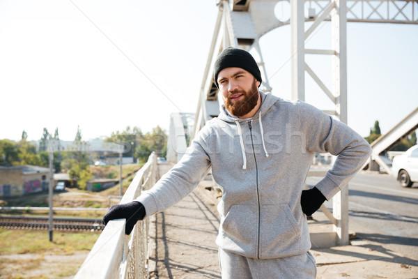 молодые спортсмен Hat тренировки моста Сток-фото © deandrobot