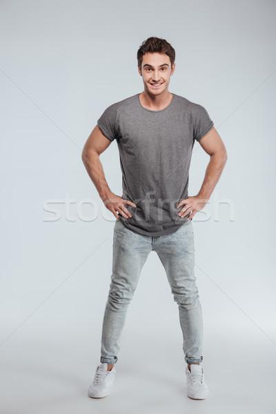 Portret knappe man permanente handen heupen Stockfoto © deandrobot