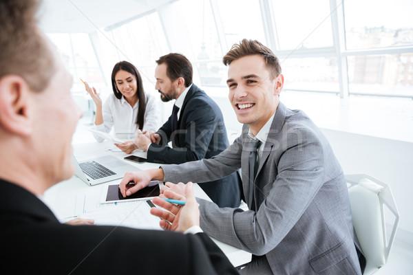 Hátulnézet idős férfi konferencia üzletember kollégák Stock fotó © deandrobot