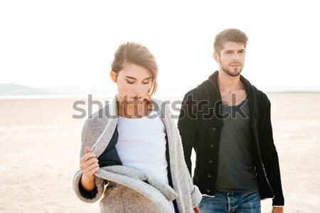 Güzel bir kadın yakışıklı adam yürüyüş sahil sonbahar sevmek Stok fotoğraf © deandrobot