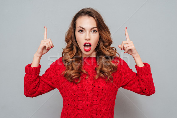 woman in red sweater attracts attention Stock photo © deandrobot