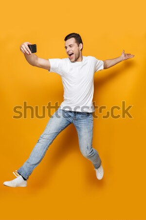 Funny bearded man wearing virtual reality device Stock photo © deandrobot