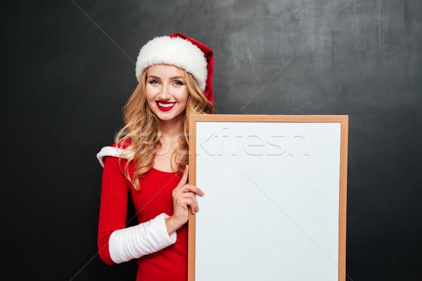 幸せ 女性 サンタクロース 帽子 ホワイトボード ストックフォト © deandrobot