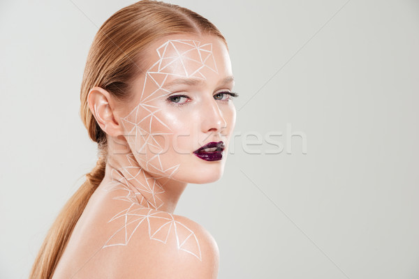Beauty image in profile of girl with body art Stock photo © deandrobot