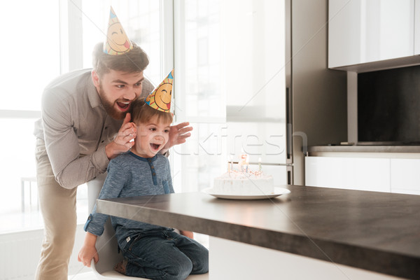 Father with birthday little son stop to covering his eyes. Stock photo © deandrobot
