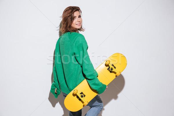 Güzel patenci kadın kaykay fotoğraf yeşil Stok fotoğraf © deandrobot