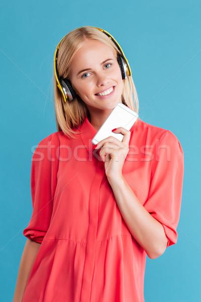 幸せ 女性 赤いドレス ヘッドホン 携帯電話 ストックフォト © deandrobot