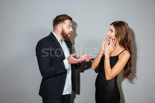 Jovem atraente casal inteligente roupa menina Foto stock © deandrobot
