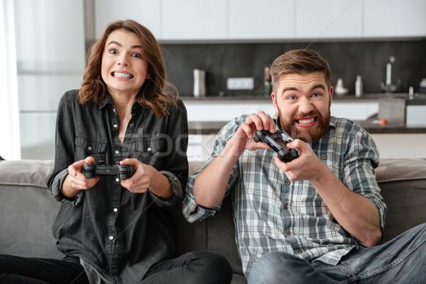 Fiatal szerető mosolyog pár játszik játékkonzol Stock fotó © deandrobot