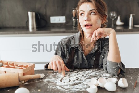 Hihetetlen hölgy ül konyha főzés fotó Stock fotó © deandrobot