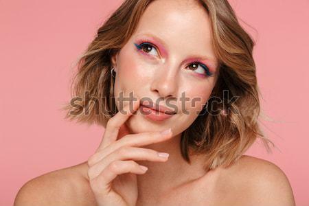 Vonzó nő áll pózol rózsaszín kép fiatal Stock fotó © deandrobot