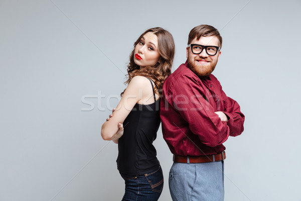Pretty woman and Male nerd standing backs to each other Stock photo © deandrobot
