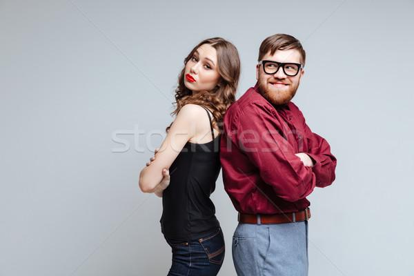 Mulher bonita masculino nerd em pé outro isolado Foto stock © deandrobot