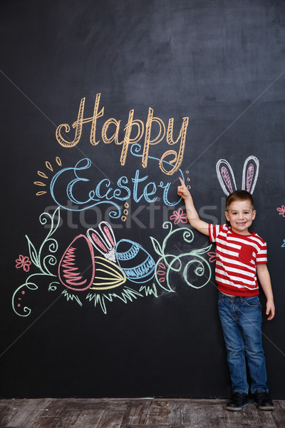 Cheerful young kid wearing bunny ears Stock photo © deandrobot