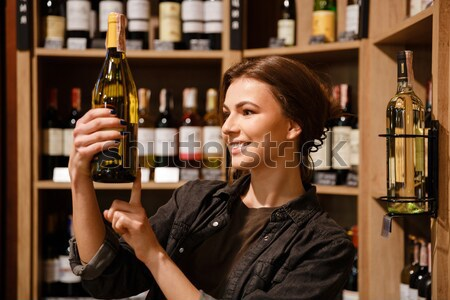 Woman choosing vine and scanning bar code Stock photo © deandrobot