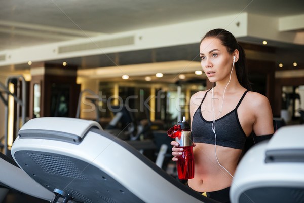 Sports lady make sport exercises indoors at gym Stock photo © deandrobot