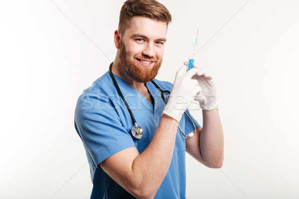 Portrait of a happy attractive medical doctor or nurse Stock photo © deandrobot