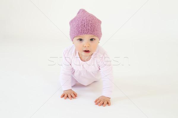 Cute little baby girl wearing hat sitting on floor Stock photo © deandrobot