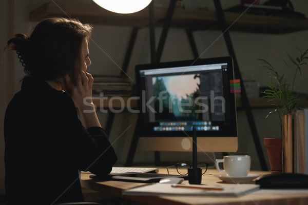 Back view photo of young woman designer talking by phone. Stock photo © deandrobot