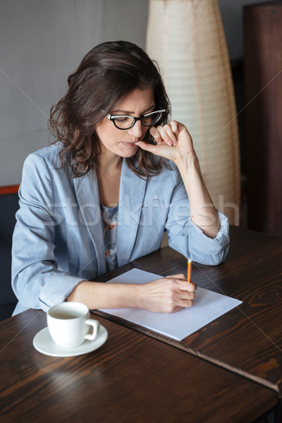 Pensando mulher escritor sessão quadro Foto stock © deandrobot