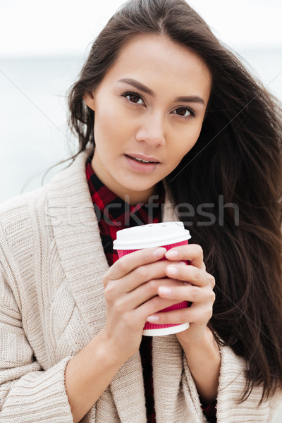 Beautiful young caucasian lady walking outdoors at beach Stock photo © deandrobot