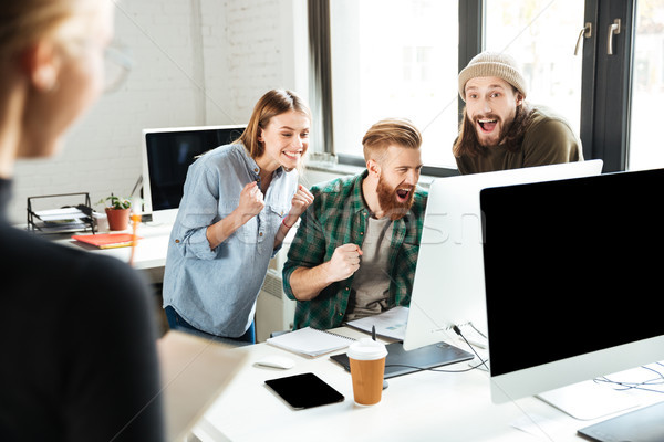 Stock photo: Smiling colleagues in office talking