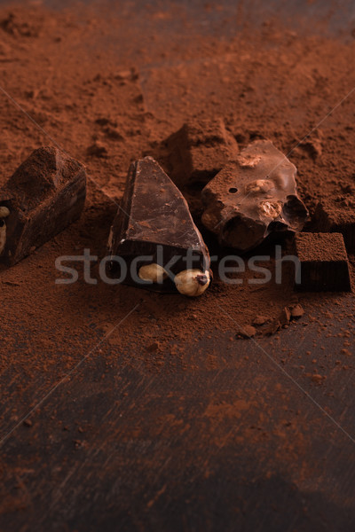 Dark crashed chocolate bar covered in powder Stock photo © deandrobot