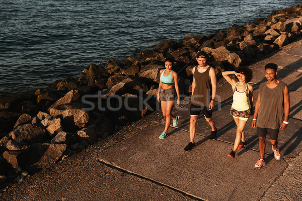 Top view of group fitness people walking on pier Stock photo © deandrobot
