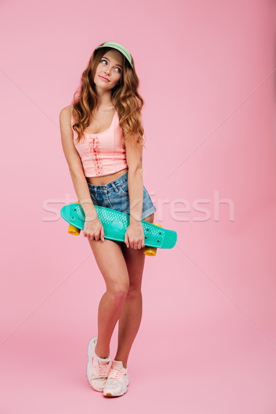 Full length portrait of a happy woman in summer clothes Stock photo © deandrobot