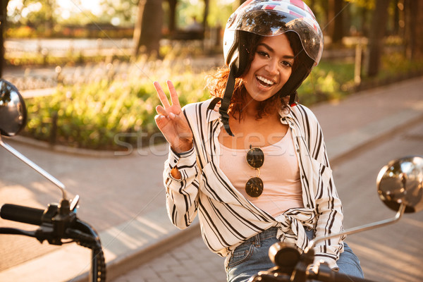 счастливым африканских женщину Мото шлема сидят Сток-фото © deandrobot