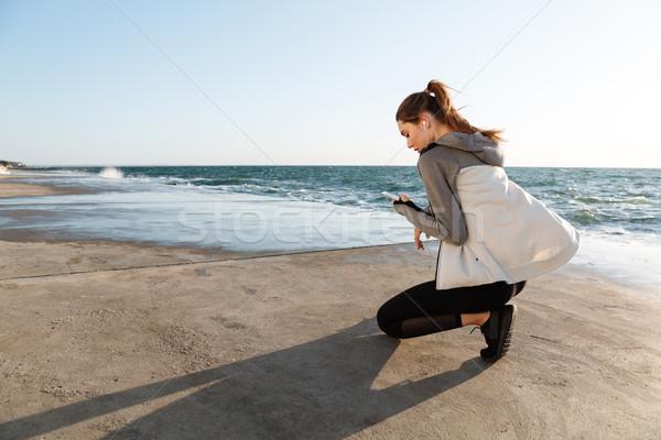 Photo stock: Vue · arrière · jeunes · sport · femme · séance · genou