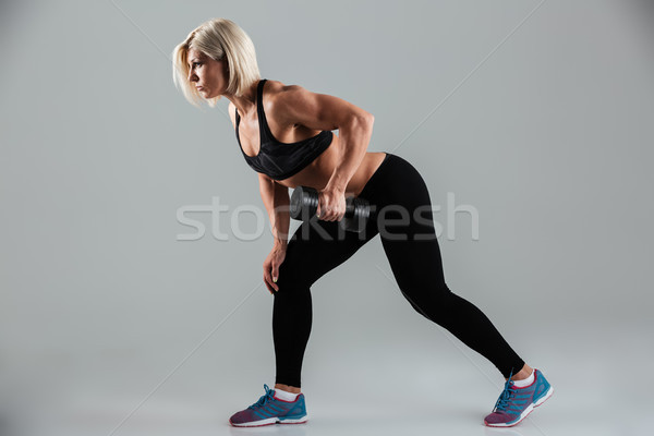 Side view portrait of a concentrated muscular adult sportswoman Stock photo © deandrobot