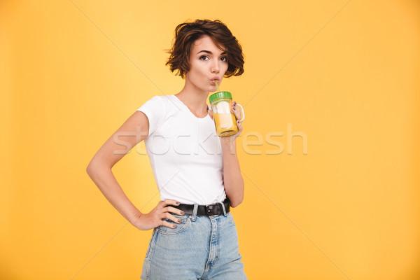 Retrato casual menina potável suco de laranja vidro Foto stock © deandrobot
