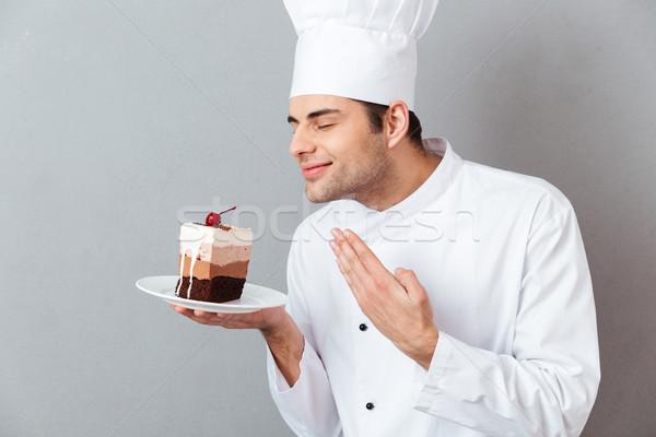 Retrato satisfecho masculina chef uniforme pieza Foto stock © deandrobot