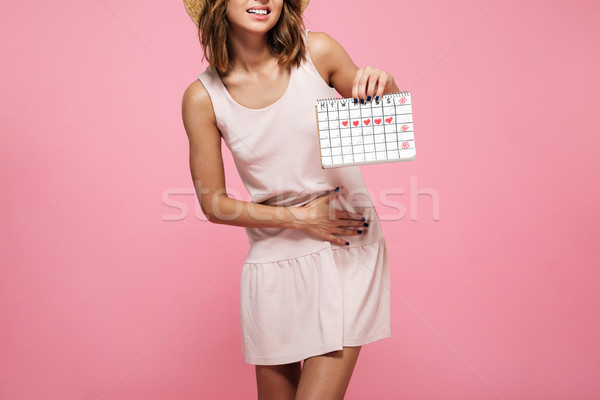 Cropped image of a young woman in dress suffering Stock photo © deandrobot
