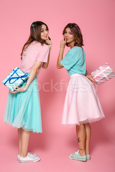 Full length photo of two charming brunette woman in children's c Stock photo © deandrobot