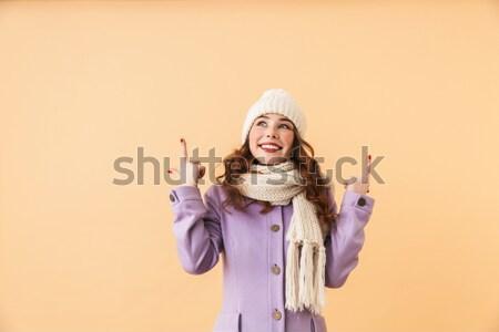Portrait of a cute little girl dressed in winter hat Stock photo © deandrobot