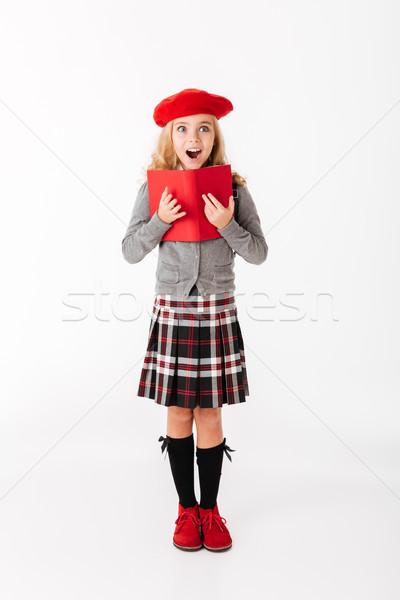 Ritratto sorpreso piccolo studentessa uniforme Foto d'archivio © deandrobot