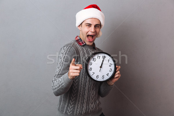 Felice urlando uomo maglione Natale Hat Foto d'archivio © deandrobot