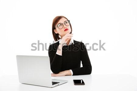 концентрированный мышления молодые бизнеса Lady используя ноутбук Сток-фото © deandrobot