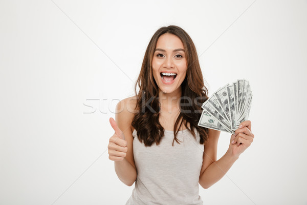 Portrait of attractive young woman with long hair holding lots o Stock photo © deandrobot