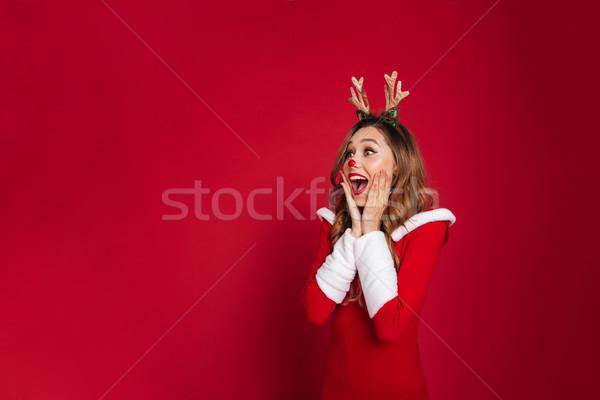 Sorpreso indossare Natale cervo costume Foto d'archivio © deandrobot