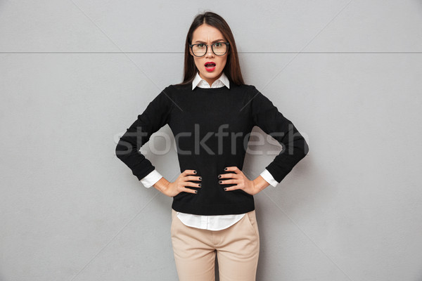 Displeased asian woman in business clothes and eyeglasses Stock photo © deandrobot