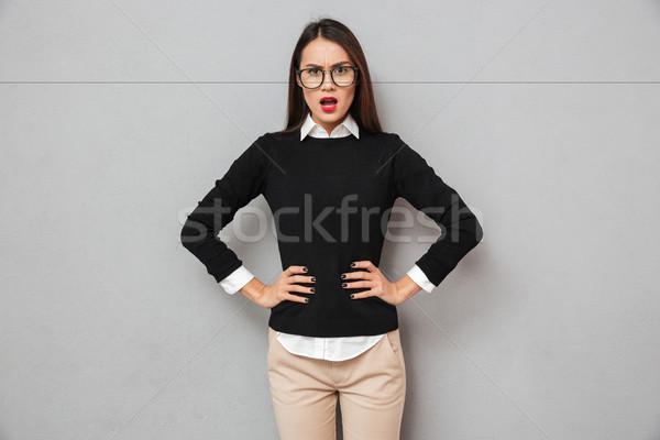 Elégedetlen ázsiai nő üzlet ruházat szemüveg Stock fotó © deandrobot