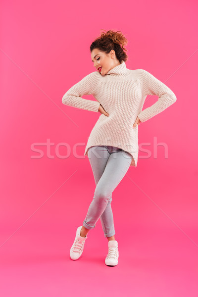 Full length portrait of a cheery attractive girl posing Stock photo © deandrobot