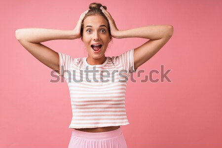 Portrait of an annoyed young woman screaming Stock photo © deandrobot